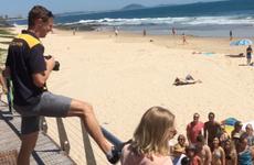 Sunshine Coast Daily photographer Iain Curry with editor Jenna Cairney on Mooloolaba beach