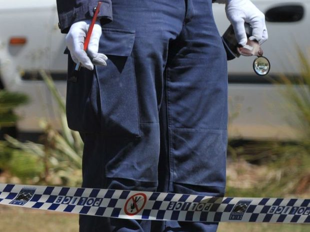 Crime scene investigator with Police tape Photo: Brett Wortman / Sunshine Coast Daily