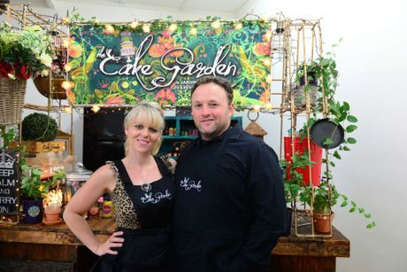 CAKE GARDEN: Amber Collins is the owner of new market caf , the Cake Garden. Pictured here with her husband Pacer Collins. Photo taken on Monday, 12 January 2015. Photo: Max Fleet / NewsMail