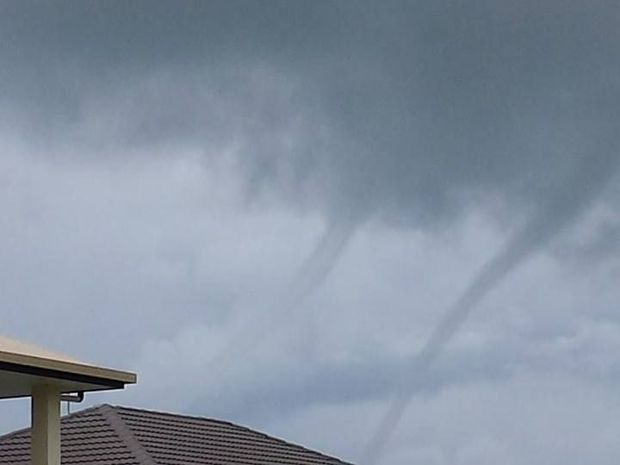 Courtney Palmer snapped this image of two water spouts off the Capricorn Coast just after 1pm today