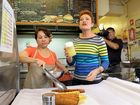 Pailine Hanson serves up some food with Marsden's Seafood owner Thanh Huynh on her return to the store on Friday. Pauline owned and operated the store for ten years before entering politics. Photo: Rob Williams / The Queensland Times