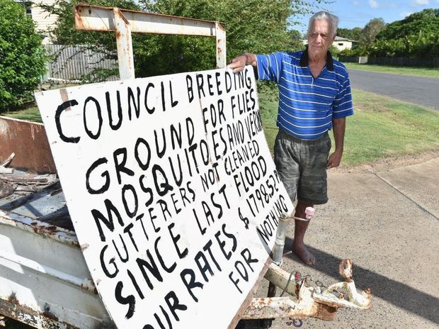 Warren Foster gets his message across about the blocked drains on Ann St, Maryborough.