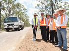 Work begins on finishing the last section of narrow roadway on Old Toogoom Rd at Torbanlea. Member for Hinkler, (L) Keith Pitt turns the first sod as Fraser Coast councillors and Kate Niblett (Howard & District Progress Assoc) look on.