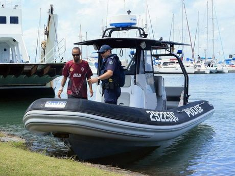 A fisherman stranded on Moonboom Island returns to the Hervey Bay marina with the Hervey Bay Water Police.