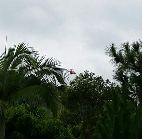 Chopper in the skies above Beerwah looking for kids missing in flood.