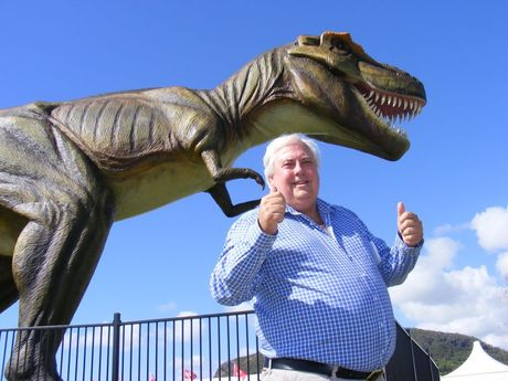 Clive Palmer with the dinosaur Jeff, during the 2012 PGA at Palmer Coolum Resort. Photo Richard Bruinsma / Sunshine Coast Daily