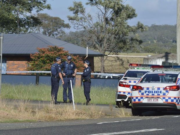 Police investigate the death of three people near Toowoomba.