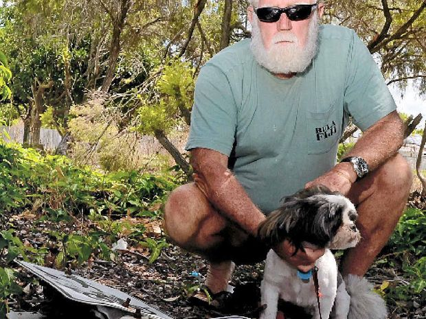 SLUGGED: Jeff Brady was fined for not walking his carer's dogs on a leash, even though there was no council signage indicating it was an offence.