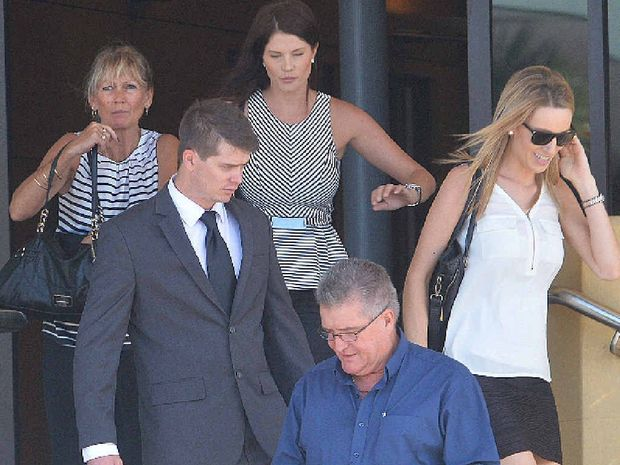 Adam Wisley leaves Mackay Courthouse with his parents and two unidentified supporters.