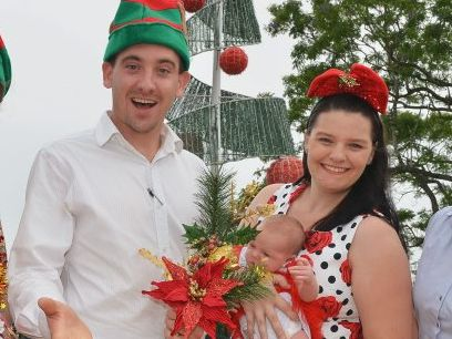 Apex president Sam Johnson with Kristy Herrod, who co-ordinated the 2014 Apex Santa Fair, with three-week-old Juliet.