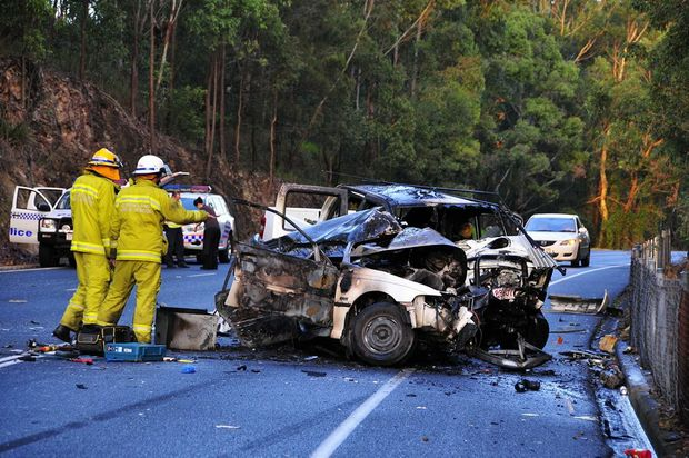 The scene of the fatal collision in July 2010 at Cooroy-Noosa Rd. Two men have been honoured with bravery awards for pulling people from this wreck.