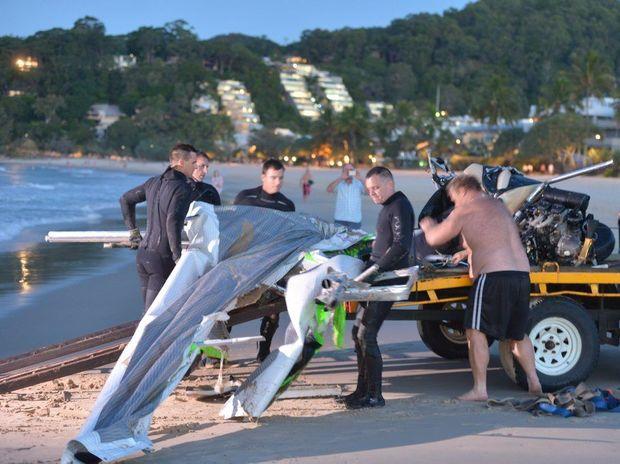 Police retrieve the ultrslight that crashed off Noosa Main beach. Photo: John McCutcheon / Sunshine Coast Daily
