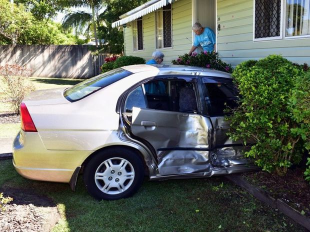Car crashes into Olive Macklins house, seriously injuring elderly driver, after collision in Poinciana Avenue Tewantin.