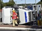 TRUCK ROLLOVER: A truck carrying slabs of cement, rolls on the corner of James and Cohoe Street. The driver with minor injuries was transported to Toowoomba Hospital. Photo Bev Lacey / The Chronicle