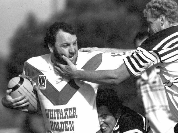 GOING DOWN: Raiders player Robert Bollinger attempts to escape a Brothers tackle in March 1994.PHOTO: FILE