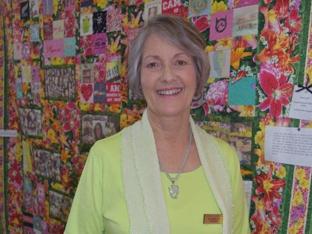 MADE WITH LOVE: Elizabeth Casimir stands in front of the quilt she made for her sister that celebrates the life of her daughter and Elizabeth's niece, Lily.