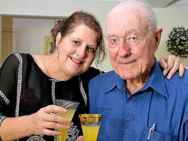 FIRM FRIENDS: Ceinie Grudnoff and John Hunt share a toast to her bravery award.