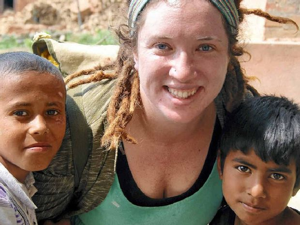 HELPING HAND: Ally Jensen with Nepali children Bishal (left) and Sundar who showed Ally around their village where 35 houses were destroyed.