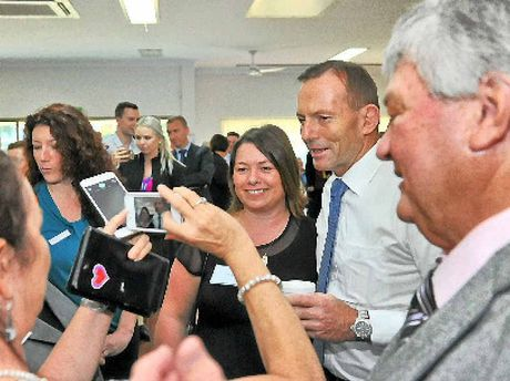 The PM with Member for Flynn Ken O'Dowd and some voters.
