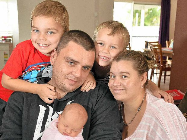 FAMILY TIME: Proud parents Anthony Turner and Rebecca Ahearn at home with baby daughter Sofia and sons Tyson, 5, and Rory, 6.