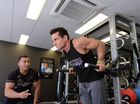 Anytime Fitness Mackay owner Mathew Chilingirian (spell correct) supports Jeronimo Garcia-Cabral as he warms up to break the Guiness World record doing Parallel Bar dips. Photo Lee Constable / Daily Mercury