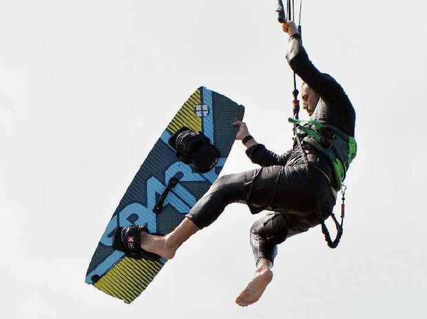AERIAL EXPERTISE: Kite surfer Ryan Bentley pulls an off the board trick at Town Beach yesterday. About 30 kite surfers took advantage of the ideal conditions.