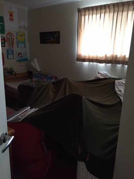 A blanket fort is a fun way for kids to pass the time on a rainy day.