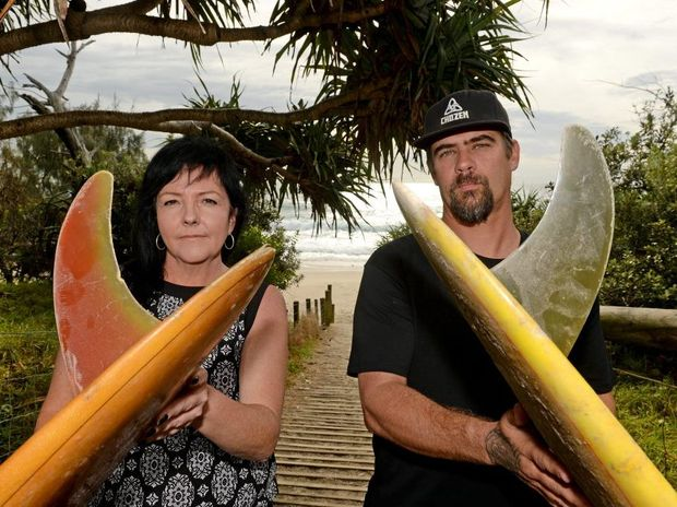 Tina Rochford and Dan Smith with a couple of single fin surfboards at Cabarita Headland. Photo: Blainey Woodham / Tweed Daily News