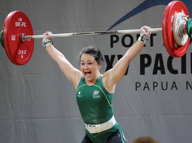STRONG PERFORMANCE: Ipswich weightlifter Erika Ropati-Frost lifts her way to a gold medal at the Pacific Games in Papua New Guinea.