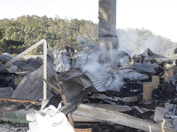 HOUSE FIRE: A Queenslander on Tidwell Road in Mount Mee still smouldering. Photo Erica Baigrie / Caboolture News