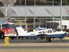 SAFE LANDING: A plane successfully landed at Toowoomba Airport despite an intial problem with the landing gear. Sunday, Jul 19, 2015 . Photo Nev Madsen / The Chronicle