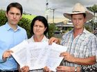 BACKLASH: Cr George Seymour, Cr James Hansen and Ergon employees Maria Fuchs and Denise Young with a petition against the new timed parking in Maryborough car parks.