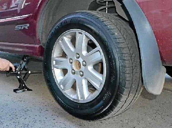 TYRE CHANGE: Scott Brereton, of Bridgestone Tyres in Casino, shows how to change a tyre easily.