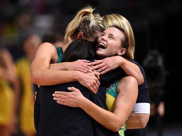 Head coach of Australia, Lisa Alexander (centre), is embraced by Laura Geitz (left) and Natalie Medhurst after their win against New Zealand during the gold medal match of the Netball World Cup at Allphones Arena in Sydney on Sunday, Aug. 16, 2015.
