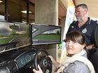 Launching Road Safety Week with driving simulators at TAFE are Veronica Iovu, from Moldova, and Toowoomba PCYC officer-in-charge Sergeant Cam Crisp.