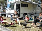 TRAVELLING AROUND: Rob and Michelle Catania, with children Jade and Henry, have started Free Range Camping, where campers provide help in exchange for somewhere to stay.