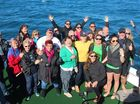 WHALE OF A TIME: Sunrise presenter Eddie Bartholomew with the crowd on board Quick Cat 2.