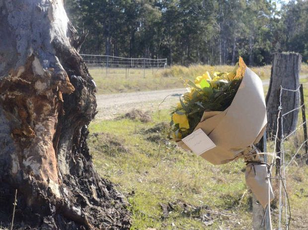 MISSED: Flowers have been laid at the site of the crash which claimed the life of 17-year-old Ramornie girl Kiara Joe, inset.