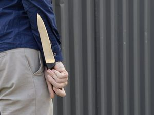 A man has been charged after holding up a store with a knife. FILE IMAGE
