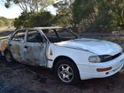 BURNT CAR: This white Toyota Camry, found at the paddock on the corner of Tooth and Hythe Sts, was set alight overnight on Thursday, September 24. Fraser Coast Chronicle / Hannah Baker