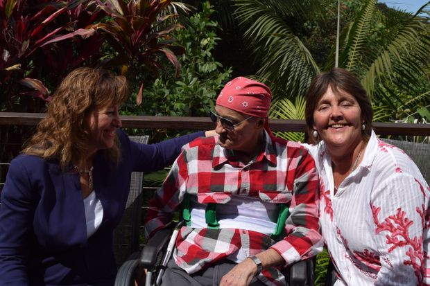 National Project Manager Liza Nagy with Charles Klaverstyn, 63, and Meredith Dennis of Tweed Palliative Support. They are at Wedgetail Retreat in Dulguigan where Charles is receiving end-of-life care.