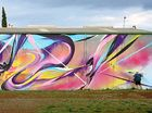 A POLISH artist has returned to Toowoomba for a large-scale mural production.
