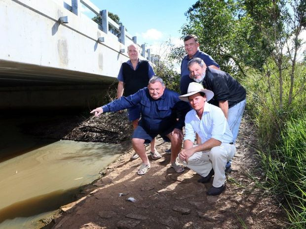 Concerned residents met with Councillor, James Hansen to discuss the issue of bringing town sewerage to Howard. From left,Temp Brown, Paul Melverton, James Hansen, Geoff Allen and Ian Farrell. Photo: Brendan Bufi / Fraser Coast Chronicle