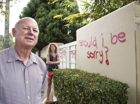 Margaret Maloney and Ian Knox are upset with the graffiti on their wall.