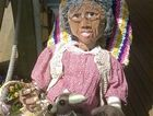 This amazing scarecrow can be found in all her glory, sitting on the deck at Nanna McGiins at Kenilworth, Queensland with a bag of lollies and her dog on a pearl lead.