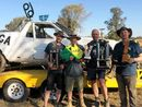 BROTHERS David and Tommy Hall emerged from a pile of mud in a Ford Falcon with an Australian championship.