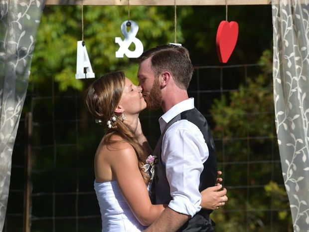 Anthony Campbell organised a secret back yard wedding for his bride Lilli Schall at Bli Bli. Photo: Warren Lynam / Sunshine Coast Daily