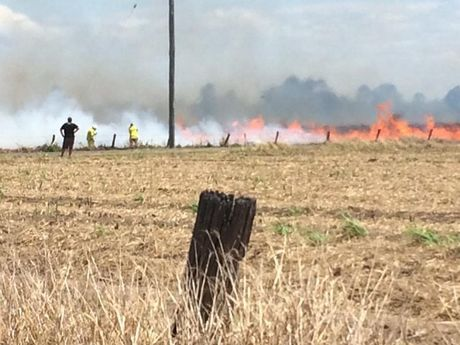 EMERGENCY: Crews attending the scene of a large grass fire in North Bundaberg. Photo Michael Brown