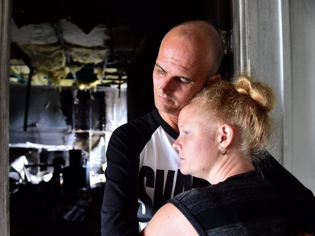 Craig and Yvette Wilson are still emotional after fire destroyed parts of the home they rent in Meridian Plains. They have been left homeless and are unsure what to do next. Photo: Che Chapman / Sunshine Coast Daily