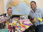 Travel consultant Sean Anstee (left) and Colin Oakley are taking close to 200kg of donated goods to an orphanage in Cambodia where they will also do volunteer work.